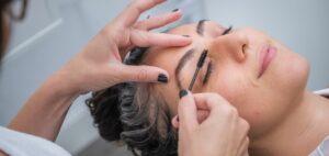 person brushing eyebrow